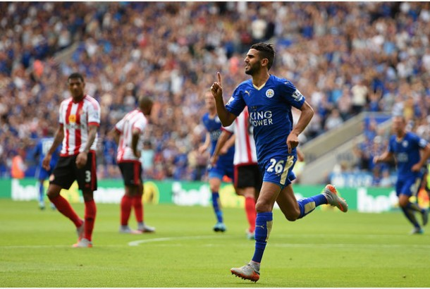 LEICESTER, ENGLAND - AUGUST 08: Riyad Mahrez of Leicester City celebrates scoring his team's second goal during the Barclays Premier League match between Leicester City and Sunderland at The King Power Stadium on August 8, 2015 in Leicester, England. (Photo by Ross Kinnaird/Getty Images)