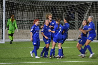 Leicester City Women celebrate one of their four goals against Derby County Ladies.